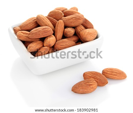 Almond in bowl, isolated on white - stock photo