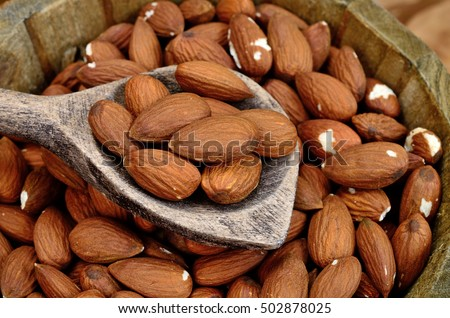 almond in bucket on wooden table