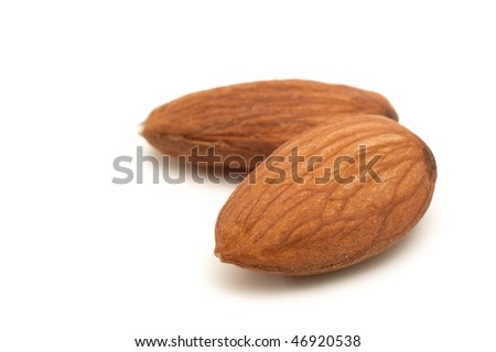 Almond macro isolated in white background - stock photo