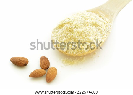 Almond meal, or almond flour, is ground almonds and used in baking as a substitute for wheat flour in baking - stock photo