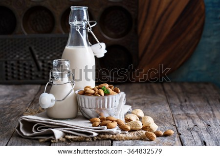 Almond nut vegan milk non dairy in different bottles with copy space - stock photo