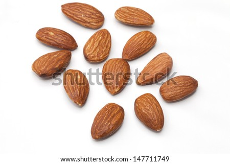 Almond nuts isolated on the white background - stock photo