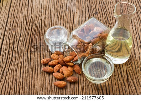 Almond oil and almonds seed for beauty spa and treatment - stock photo