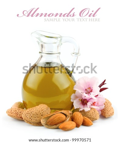almond oil with nuts of almonds and flowers of almonds