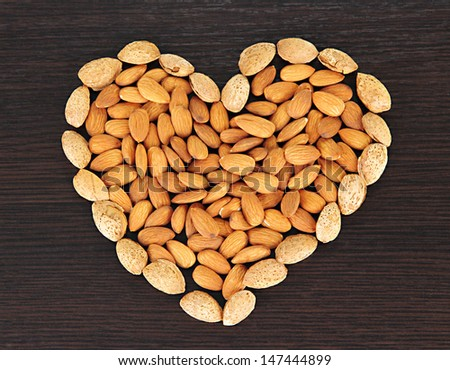Almond on dark wooden background - stock photo