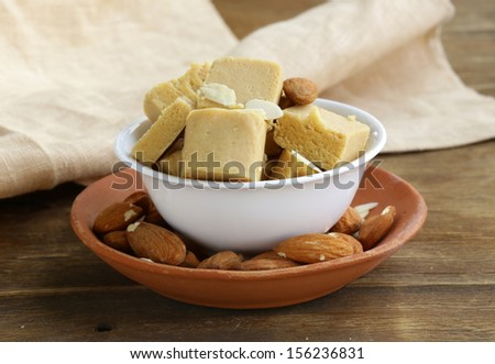almond paste - marzipan in a bowl with whole nuts - stock photo