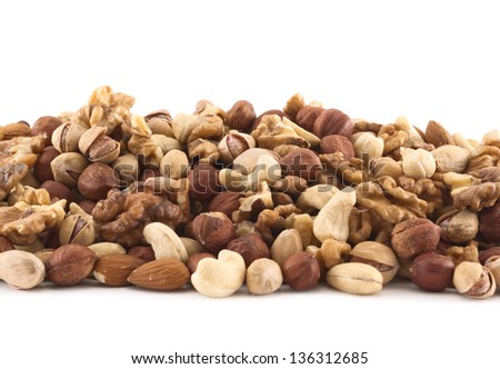 Almond, pistachio, peanut, walnut, hazelnut mixed pile as a background composition