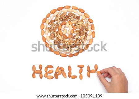 Almond,pistachios and wall nuts are arranged on white - stock photo
