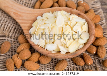 almond slices in  a wooden spoon - stock photo