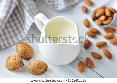 Almond with almond milk on a  checkered table - stock photo