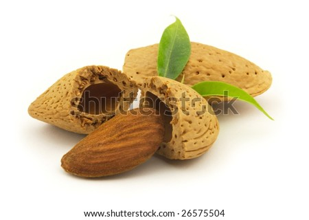 Almond with leaves on a white background - stock photo