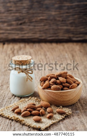almond with milk on wooden table