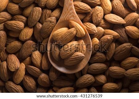 Almonds. Almonds on dark tone. Almonds background. Group of almonds. Peeled almonds. Pile of almonds. Almonds kernel. Almonds nuts. - stock photo