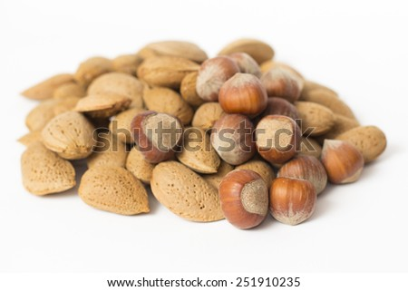 Almonds and nuts isolated on white background - stock photo