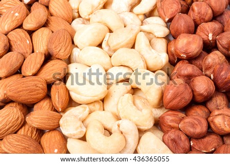 almonds cashews and hazelnuts peeled as background - stock photo