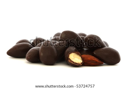 Almonds covered in dark chocolate - one cut in half and one naked (without chocolate) - stock photo