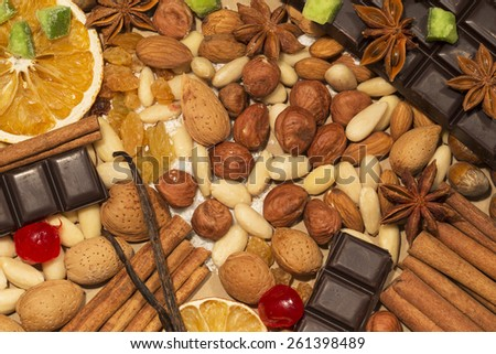 Almonds, hazelnuts and spices with chocolate - stock photo