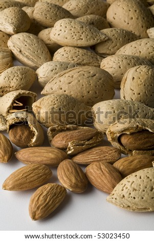 Almonds in shell and out of shell - stock photo