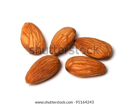 Almonds isolated on white background. Close up view. - stock photo