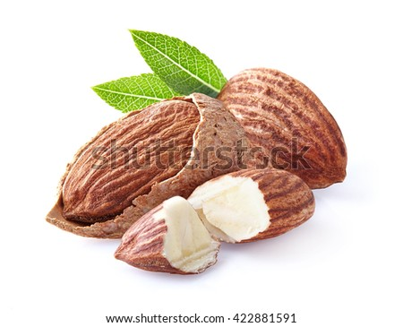 Almonds kernel with leaf - stock photo