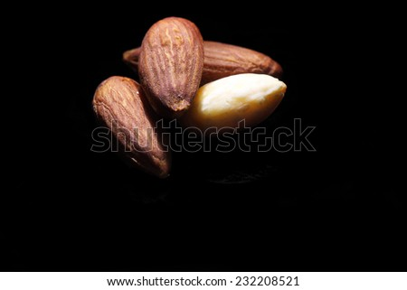 almonds macro black isolated - stock photo