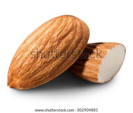 Almonds nut with half isolated on white background - stock photo