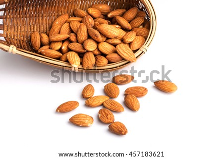 Almonds nuts with bamboo bukag isolated on white background. - stock photo
