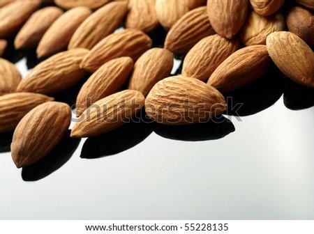 Almonds on black backgrond - stock photo