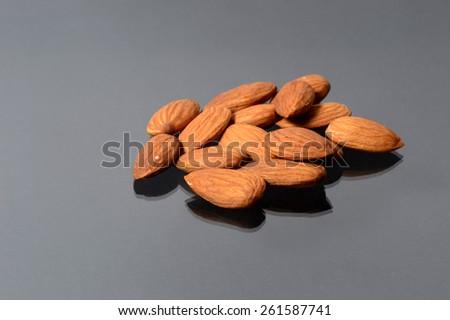 Almonds on black background   - stock photo