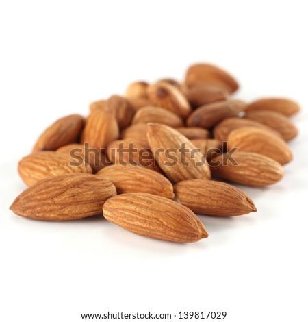 almonds on white - stock photo