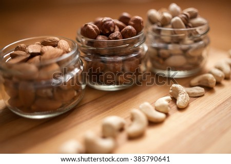 Almonds, walnuts and hazelnuts in glass jar