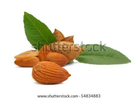 Almonds with green leaves - stock photo