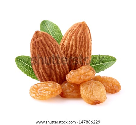 Almonds with raisins in closeup - stock photo
