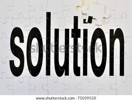 """Almost finished puzzle to depict the concept """"almost found the solution"""". - stock photo"""