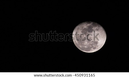 Almost full moon (gibbous moon) with space for text on the left