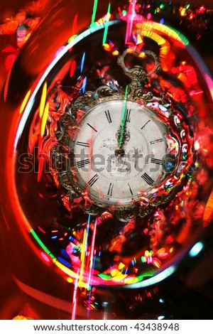 almost midnight: antique watch amidst bright festive abstract - stock photo