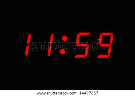 Almost Twelve O'clock - digital clock displaying 11 59 - stock photo