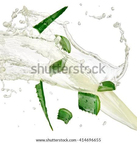 Aloe slices and juice splash, close up - stock photo