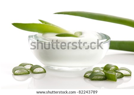 aloe vera - leaves and cream isolated on white background - stock photo