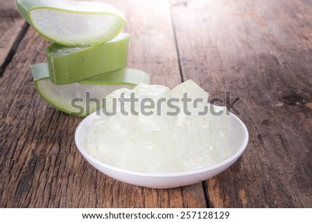 aloe vera on wooden background - stock photo