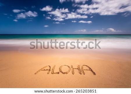 Aloha written in the sand on the beach of Kapaa, Kauai, Hawaii - stock photo