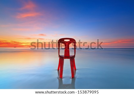 alone chair on the beach  - stock photo