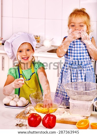 Alone children in  flour breakfast at home kitchen