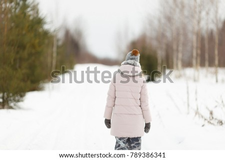 alone girl in the winter forest