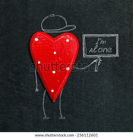 alone heart on the chalkboard - stock photo