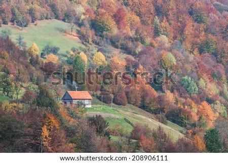 alone house in autumn mountain - stock photo