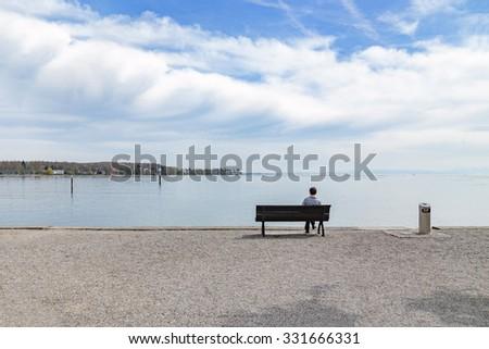 Alone man at the beach - stock photo