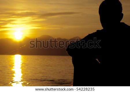 Alone Man drinking on the beach - stock photo