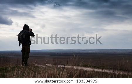 Alone nature Photographer shoots the landscape - stock photo
