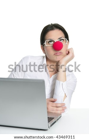 Alone office woman laptop clown nose sad expression - stock photo